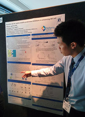 photo of Lewis presenting his poster at medical student conference