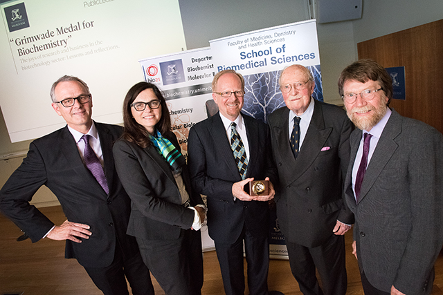 photo of Dr Russell Howard and colleagues at the award ceremony