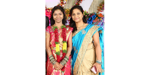 Vijaya and her sister, pictured at her sister's wedding