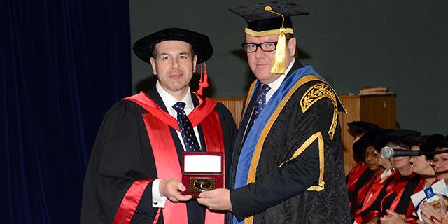 photo of Professor Gordon Lynch receiving award