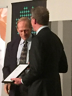 Professor John Furness (L) receiving his Fellowship