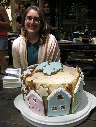 photo of Jeniffer Juno and the Christmas cake she made for us